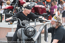 Jack and Caro Dlude of Montreal Canada check out a new 2017 Road King Special at the Harley-Davidson display at the Daytona Speedway during Daytona Bike Week. Daytona Beach, FL. USA. Monday March 13, 2017. Photography ©2017 Michael Lichter.