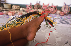 Close-up of weaving technique where the weaving materials are held by the toes of a local craftsperson in Panama City, Panama, Central America.