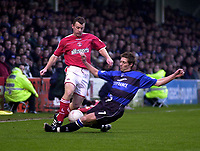 Photo. Glyn Thomas.<br /> Gillingham v Charlton. FA Cup Third Round.<br /> Priestfield Stadium. 03/01/2004.<br /> Nicky Southall (R) slides in to tackle Graham Stuart.