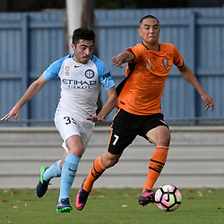 BRISBANE, AUSTRALIA - DECEMBER 3: Christian Cavallo of the City and Joseph Champness of the Roar compete for the ball during the round 4 Foxtel National Youth League match between the Brisbane Roar and Melbourne City at AJ Kelly Field on December 3, 2016 in Brisbane, Australia. (Photo by Patrick Kearney/Brisbane Roar)