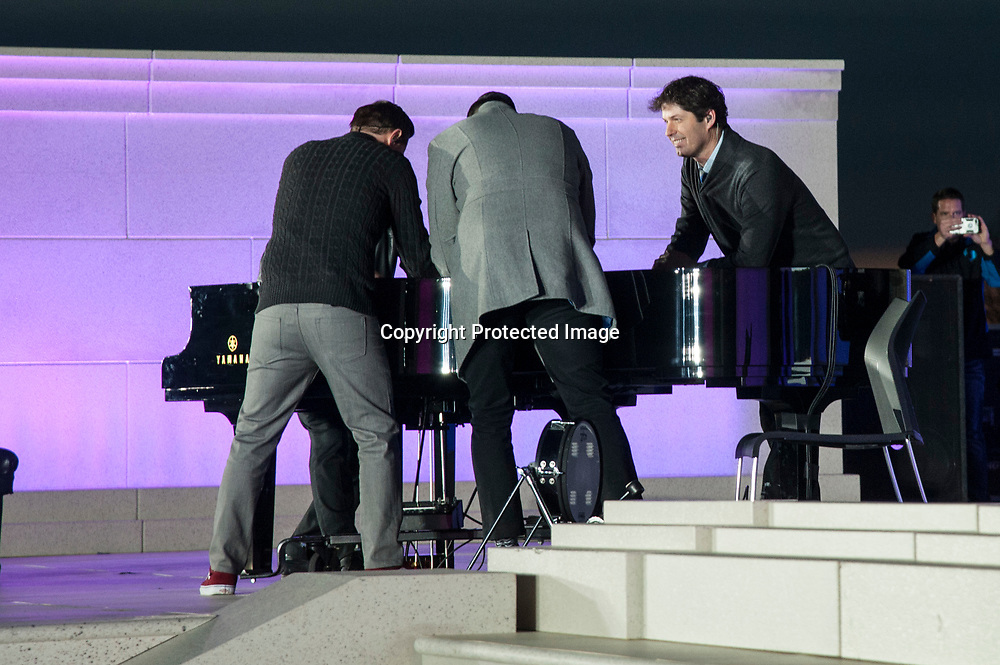 Jon Schmidt , Steven Sharp Nelson, Tel Stewart  and Al van der Beek of The Piano Guys perform during The 58th Presidential Inauguration Welcome Concert at the Lincoln Memorial in Washington DC on January 19, 2017.