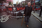 Ian Bone publisher of anarchist newspaper Class War seen here with protesters at Class War march on Boris Johnson's house in Islington on Friday 15th July in London, United Kingdom. The anarchist group organised this event weeks ago well before Boris Johnson became Foreign Secretary, which has only inflamed the anger amongst protesters at the class and wealth divide between rich and poor and the gentrification of London.