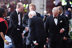 The Duke of Sussex, the Duke of Cambridge and the Prince of Wales greet Sir David Attenbrough attending the global premiere of Netflix's Our Planet, held at the Natural History Museum, London.