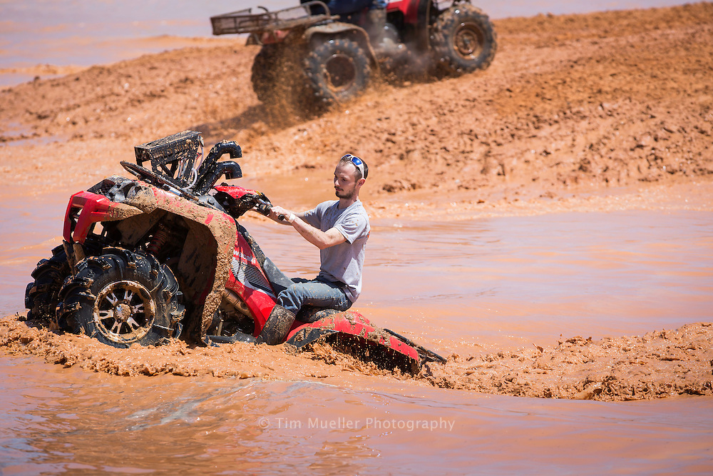 Travis Kemp slogs through a mud pit at Muddy Bottoms ATV & Recreation Park in Webster Parish. The park provides outdoor enthusiast with 5,000 acres of trails, bogs and tracks. Park amenities includes a welcome center, bathhouse, pro shop, eating pavilion, amphitheater, cabins, RV hookups, and a sprinkler park.