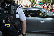 Following recent terror attacks, security is heightened with more armed police on the streets, policing important buildings, as here at Downing Street as dignitaries leave within protected cars in London, England, United Kingdom.