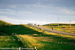 Riding to the Buffalo Chip, Sturgis, South Dakota, 1992<br /> <br /> Limited Edition Print from an edition of 50. Photo ©1992 Michael Lichter.<br /> <br /> The Story:Looking back to the earlier days of the Buffalo Chip, it seemed you really were just riding out to a field filled with Buffalo Chips. It was an out-of-town alternative to Main Street and it filled the void left by the closing of City Park. after 1982. There weren't big lines of traffic, turn signals, big signs nor big sponsors, but you always knew you would have a big time. You just didn't know what kind a a big time that would be.