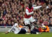 Photo: Olly Greenwood.<br />Arsenal v Tottenham Hotspur. The Barclays Premiership. 02/12/2006. Arsenal's Emmanuel Eboue goes past Tottenham's Steed Malbranque
