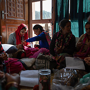 Members of the women's knitting circle work on various pieces at their weekly Wednesday meeting in Ranikhet, India, on Dec. 4, 2018.