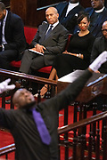 Democratic presidential hopeful Gov. Deval Patrick, center, sits with LaJoia Broughton as they watch a performance during Sunday service at the historic Mother Emanuel AME Church January 1, 2020 in Charleston, South Carolina. The service celebrated Emancipation Day, marking the abolition of slavery in the United States.