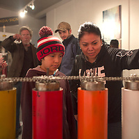Terri Laughlin, right, and her son Theron Tso operate an Algebra Machine by artist and architect Fitz Sargent at his interactive show in Art123 in Gallup during Arts Crawl Saturday.