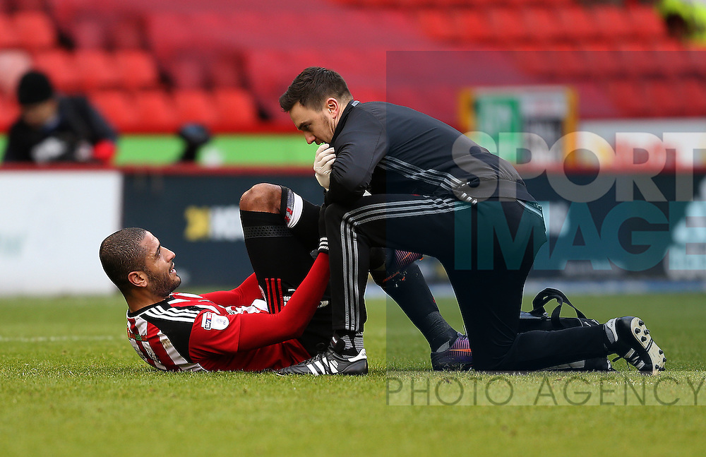 Leon Clarke of Sheffield Utd receives treatment during the English League One match at Bramall Lane Stadium, Sheffield. Picture date: December 31st, 2016. Pic Simon Bellis/Sportimage