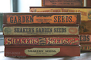 Boxes of prize Shaker seed sit stacked on table at Shaker Village of Pleasant Hill, Kentucky.