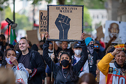 © Licensed to London News Pictures. 09/06/2020. London, UK. People march towards Downing Street after marking the funeral of George Floyd with a minute's silence in Parliament Square. Protests have taken place across the United States and in cities around the world in response to the killing of George Floyd by police officers in Minneapolis on 25 May. Photo credit: Rob Pinney/LNP