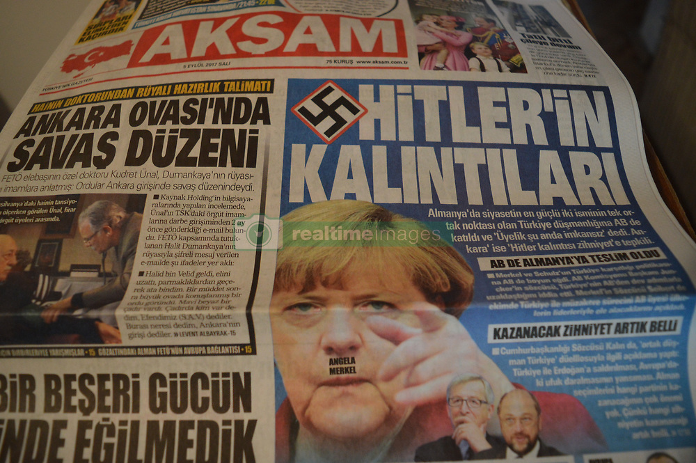 September 5, 2017 - Ankara, Turkey - Takvim, a pro-government Turkish daily newspaper, appears with the Swastika on its front page and a headline that reads 'Hitler's remnants' in Ankara, Turkey on September 05, 2017. The daily also depicts German Chancellor Angela Merkel with a picture has the letters of her name placed on her upper lip, where it appears as a 'Hitler Beard' (Credit Image: © Altan Gocher/NurPhoto via ZUMA Press)