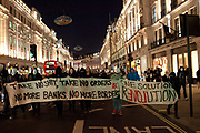 Thousands of protesters, some masked meet in Trafalgar square and march around central London marking 5th November guy fawkes night, some inceidents were reported and scuffles with the Police in Parliament square, Buckingham palace, Regent Street, Picadilly and Oxford street
