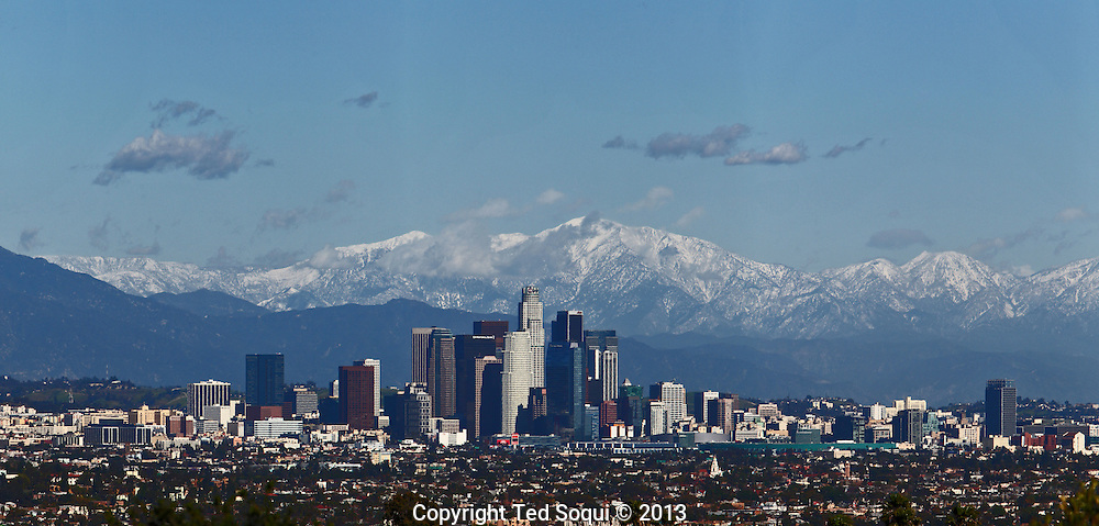 Downtown Los Angeles with the snow covered San Gabriel Mountains..