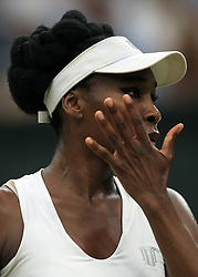 11 July 2017 -  Wimbledon Tennis (Day 8) - Venus Williams (USA) gestures to ask for a towel to wipe her face - Photo: Marc Atkins / Offside.