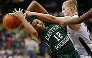 Notre Dame's Lindsay Schrader (24) fouls Eastern Michigan's Lindsey Mahone (12).