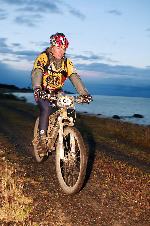 Canadian Jari Kirkland Mountain Biking in Patagonia, Chile, South America while competing in the 2009 Wenger Patagonia Expedition Race. .Copyrighted work .Permission must be sought before use of this image..Alex Ekins .0114 2630277.07901883 994