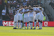 Leeds United huddle during the Sky Bet Championship match between Middlesbrough and Leeds United at the Riverside Stadium, Middlesbrough, England on 27 September 2015. Photo by Simon Davies.