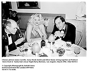 Clinton advisor James Carville, Anna Nicole Smith and Oliver Stone sitting together at Producer Steve Tisch &  Vanity Fair's Oscar Night Party,<br />
