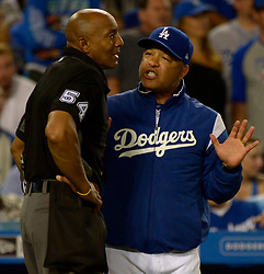 June 24, 2017 - Los Angeles, California, U.S. - Los Angeles Dodgers manager Dave Roberts talks with home plate umpire CB Bucknor (54) after a fan interference call on a double by Chase Utley (not pictured) in the sixth inning of a Major League baseball game at Dodger Stadium on Saturday, June 24, 2017 in Los Angeles. Los Angeles Dodgers won 4-0. (Photo by Keith Birmingham, Pasadena Star-News/SCNG) (Credit Image: © San Gabriel Valley Tribune via ZUMA Wire)
