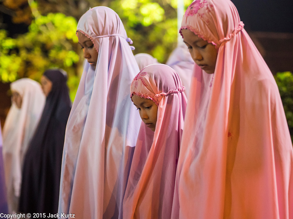 19 JUNE 2015 - PATTANI, PATTANI, THAILAND: Muslim women pray during Ramadan services at Krue Se Mosque. Krue Se Mosque was started in 1583 but never completely finished. Ramadan is the ninth month of the Islamic calendar, and is observed by Muslims worldwide as a month of fasting to commemorate the first revelation of the Quran to Muhammad according to Islamic belief. This annual observance is regarded as one of the Five Pillars of Islam. Islam is the second largest religion in Thailand. Pattani, along with Narathiwat and Yala provinces, all on the Malaysian border, have a Muslim majority.             PHOTO BY JACK KURTZ