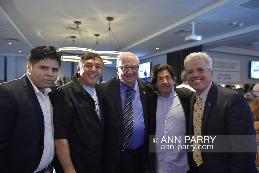 Garden City, New York, USA. November 6, 2018. Nassau County Democrats watch Election Day results at Garden City Hotel, Long Island. At center is NYS Senator JOHN BROOKS won re-election to NYS Senate SD8, and at far right is Suffolk County Executive STEVE BELLONE