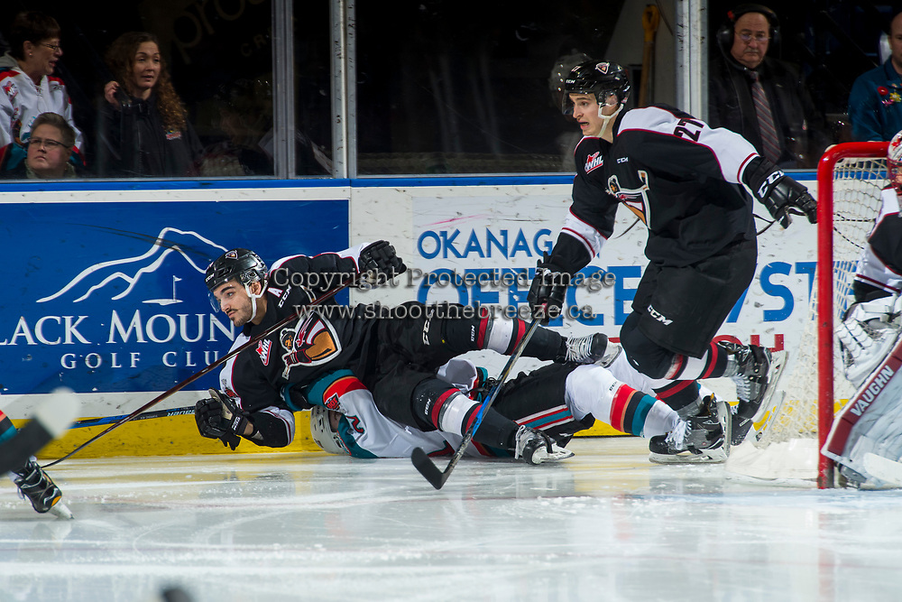 KELOWNA, CANADA - MARCH 7:  Matt Barberis #24 of the Vancouver Giants lands on James Hilsendager #2 of the Kelowna Rockets after a check behind the net on March 7, 2018 at Prospera Place in Kelowna, British Columbia, Canada.  (Photo by Marissa Baecker/Shoot the Breeze)  *** Local Caption ***