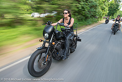 Lilly James and the Iron Lilies out riding during Laconia Motorcycle Week 2016. NH, USA. Sunday, June 19, 2016.  Photography ©2016 Michael Lichter.