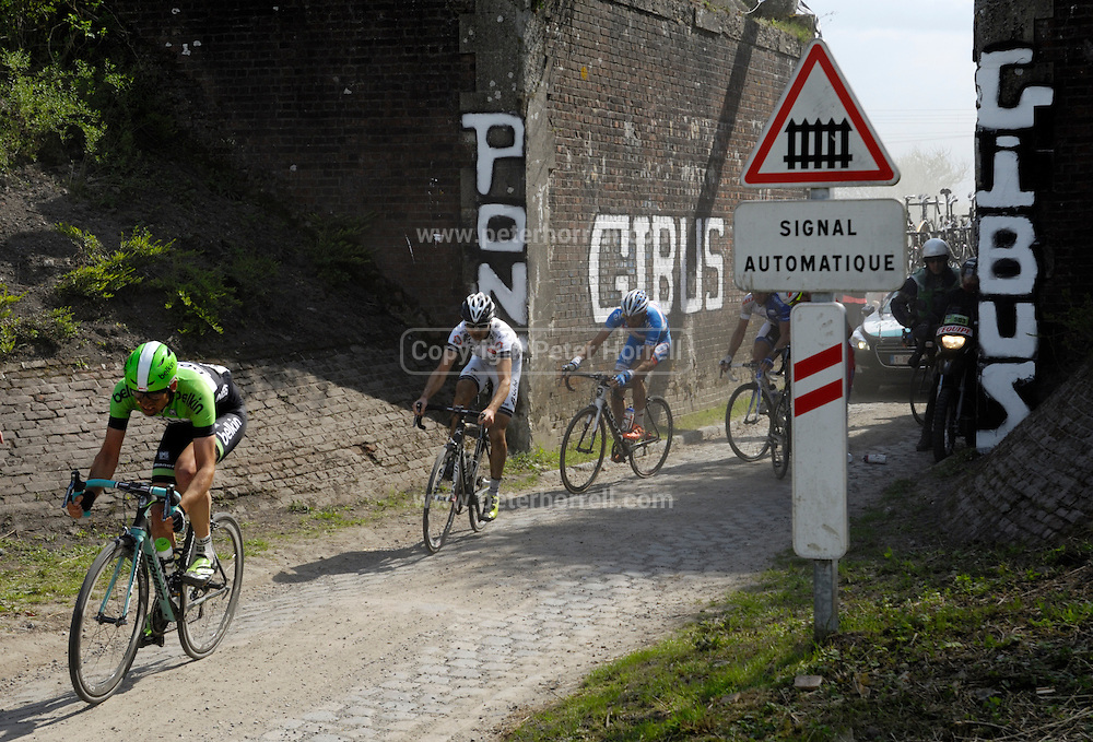 France, April 13th 2014: More riders pass through Pont Gibus, Wallers, during the 2014 Paris Roubaix cycle race.