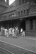 Freddy and Carol Hirschman (far right) waiting for train at the Michigan Central Depot (now Gandy Dancer Restaurant), Ann Arbor, Michigan.