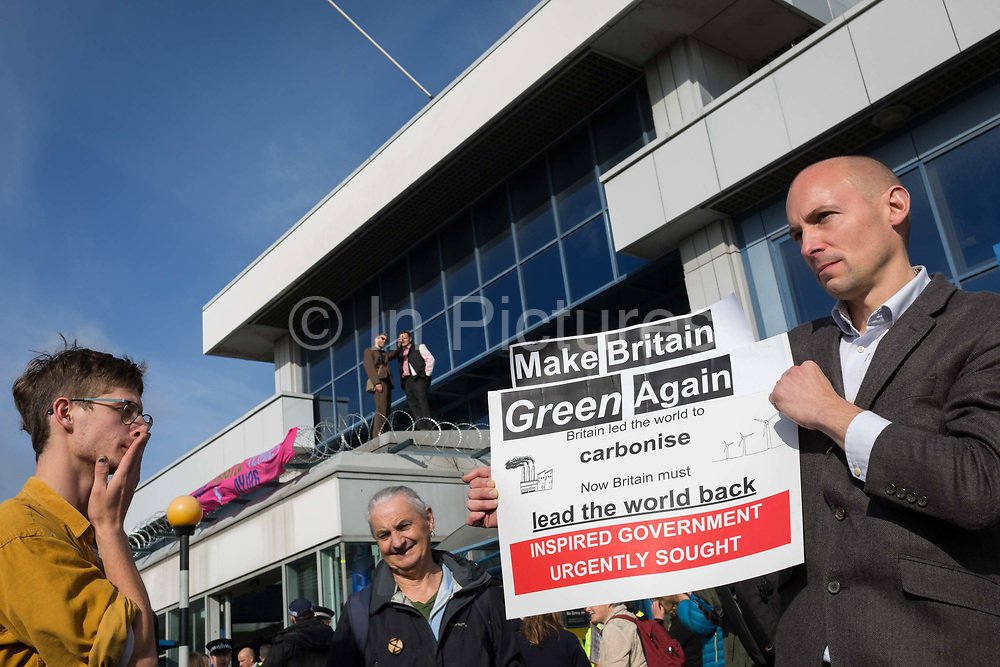 Environmental activists protest about Climate Change during the occupation of City Airport Londons Business Travel hub in east London, the fourth day of a two-week prolonged worldwide protest by members of Extinction Rebellion, on 10th October 2019, in London, England.