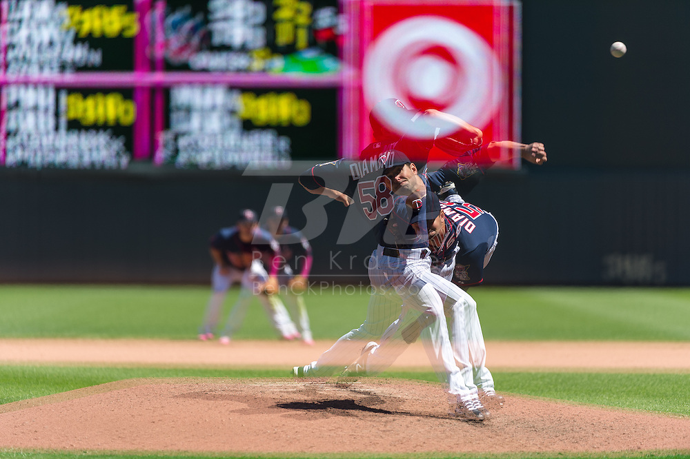 [Note: This photo was created by combining multiple exposures in-camera.] Scott Diamond #58 of the Minnesota Twins pitches against the Baltimore Orioles on May 12, 2013 at Target Field in Minneapolis, Minnesota.  The Orioles defeated the Twins 6 to 0.  Photo: Ben Krause