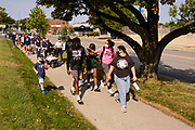 07 SEPTEMBER 2020 - DES MOINES, IOWA: About 300 Des Moines Public School (DMPS) high school athletes and members of the public march through Des Moines to the Governor's Mansion Monday to protest Gov. Kim Reynolds' recent efforts to reopen schools. DMPS, the largest school district in Iowa, is suing to go to online instruction because of the COVID-19 pandemic. The Governor is trying to force the district to reopen with in person instruction. The state ruled that schools using online education can't participate in extracurricular activities, including sports. The student athletes, who all wore face masks to comply with CDC guidelines, were marching to demand the ability to participate in sports despite using online instruction.      PHOTO BY JACK KURTZ