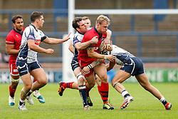Bristol Number 8 Mitch Eadie is tackled - Photo mandatory by-line: Rogan Thomson/JMP - 07966 386802 - 14/09/2014 - SPORT - RUGBY UNION - Leeds, England - Headingley Carnegie Stadium - Yorkshire Carnegie v Bristol Rugby - Greene King IPA Championship.