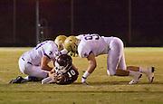 23 SEPTEMBER 2011 - SCOTTSDALE, AZ: Desert Mountain QB Kyle Allen is brought down 1st qtr at Desert Mountain High School in Scottsdale. Desert Mountain played Notre Dame in Desert Mountain's homecoming high school football game.    PHOTO BY JACK KURTZ