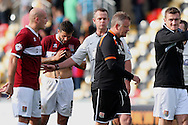 Northampton manager Chris Wilder (second right) turns away after confronting referee Christopher Sarginson at the end of the match.  Skybet football league two match, Newport county v Northampton Town at Rodney Parade in Newport, South Wales on Saturday13th Sept 2014<br /> pic by Mark Hawkins, Andrew Orchard sports photography.