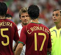 Photo: Chris Ratcliffe.<br /> England v Portugal. Quarter Finals, FIFA World Cup 2006. 01/07/2006.<br /> David Beckham of England shakes hands with Cristiano Ronaldo.