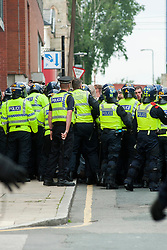 The English Defence League (EDL) return to Sheffield to lay flowers at Sheffield War Memorial after doing so they are contained on West Street until police can find a safe route to use to escort them to Sheffield Railway Station<br /> <br /> 8 June 2013<br /> Image © Paul David Drabble<br /> www.pauldaviddrabble.co.uk
