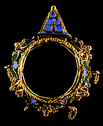 Gold ring, the bezel set with a crystal engraved with a shield of arms opening on a hinge showing a compass and dial.  Gold gabled Jewish marriage-ring. The inside of the hoop has a smooth plain surface except for the undisguised seam where the two ends join and slightly overlap. On the exterior the central broad zone is bordered on either side by a narrow band of cable ornament comprising a larger and more complex double twisted wire cable placed between a rope of simple single twisted wire. The central broad zone is occupied by five projecting openwork bosses of filigree work with applied pellets of gold in the manner of granulation. German or Italian 16th century