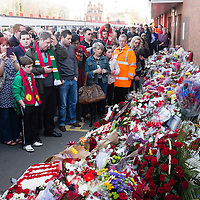 Anfield, Liverpool, UK. 15th April, 2014. On the 25th anniversary of the Hillsborough disaster over 20,000 fans visit Liverpool Football Club's grounds at Anfield to pay their respects to the 96 who died.