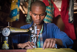 4 June 2019, Meiganga, Cameroon: Abassi Moussa works as a tailor in a shop in the Ngam refugee camp. He has been trained through the Lutheran World Federation's World Service programme in an effort to strengthen livelihoods for refugees in the area. Supported by the Lutheran World Federation, the Ngam refugee camp, located in the Meiganga municipality, Adamaoua region of Cameroon, hosts 7,228 refugees from the Central African Republic, across 2,088 households.