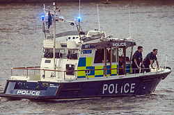Emergency personnel on the river Thames next to Westminster Bridge, close to the Palace of Westminster, London, after at least two people have died after a knifeman brought terror to the heart of Westminster, mowing down pedestrians then stabbing a policeman before he was shot by armed officers.