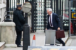 © Licensed to London News Pictures. 05/12/2017. London, UK. Secretary of State for Exiting the European Union David Davis arriving in Downing Street to attend a Cabinet meeting this morning.Yesterday, Brexit negotiations on the Northern Ireland border were stalled when Arlene Foster of the DUP said she could not support commitment to keep Northern Ireland aligned with EU laws. Photo credit : Tom Nicholson/LNP