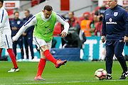 England Forward Wayne Rooney warms up before kick off during the FIFA World Cup Qualifier match between England and Malta at Wembley Stadium, London, England on 8 October 2016. Photo by Andy Walter.