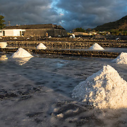 Salt pans in Tamarin where sea water is pumped into large, shallow basalt pans and left to evaporate. The salt is then harvested by workers.