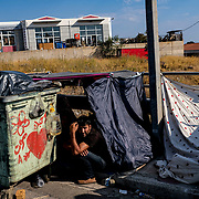 MYTILENE, GREECE - SEPTEMBER 12: Displaced asylum seekers can be seen camped on the side of the road days after the Moria migrant camp fires, which started Tuesday night, and ended up burning most of the encampment on September 12, 2020 in Mytilene, Greece. According to UNHCR, current numbers say the asylum-seekers displaced from the encampment are around 12,000. (Photo by Byron Smith for CNN)