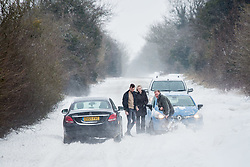 © Licensed to London News Pictures 02/03/2108, Cirencester, UK. Motorists stuck on the Gloucester road between Cirencester and Gloucestser  digging themsleves out of the  snow drifts covering the road . Photo Credit : Stephen Shepherd/LNP
