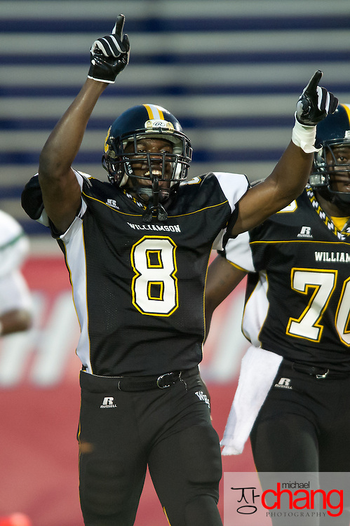 Williamson's Rush Shirley (8) reacts after scoring the first touchdown of the night while playing against .vigor at Ladd-Peebles Stadium Thursday, Sept. 13, 2012, in Mobile, Ala. At halftime Vigor leads Williamson 14-7. (Press-Register, Michael Chang) SPORTS.